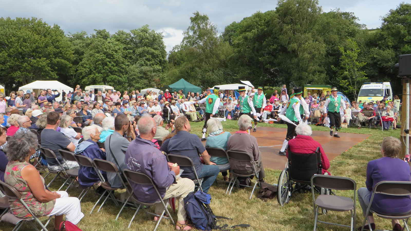 A view of the early morning crowd watching Morris dancers.