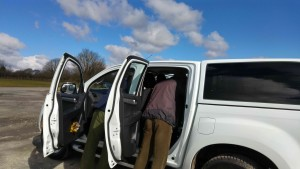 Examining the vehicle from bonnet to boot.
