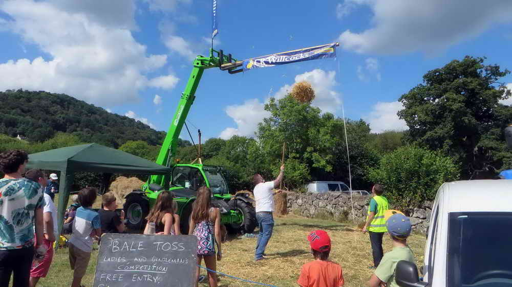 """The """"bar"""" for bale tossing, with a bale on its way up."""