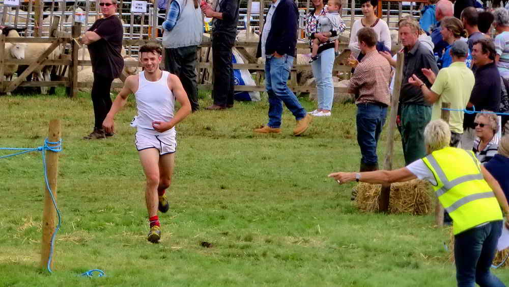 One of the first runners home in the Uncle Tom Cobley Downhill Race.