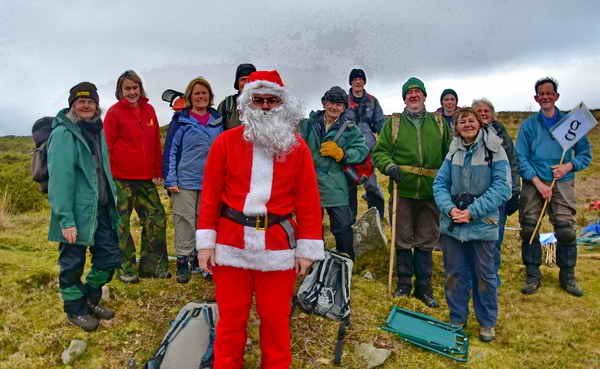 Santa posing for a group photo. Photo: Adam Sparkes