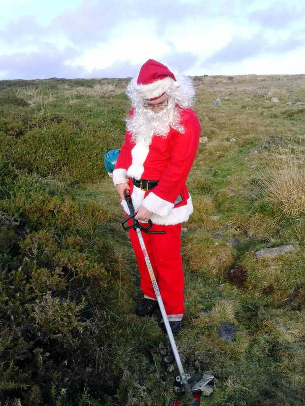 Santa tries his hand at strimming. Photo: Derek Collins