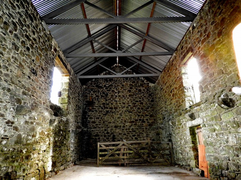 The interior of Lowery Barn. Note the granite corbels or footers to support the beams of the upper floor.