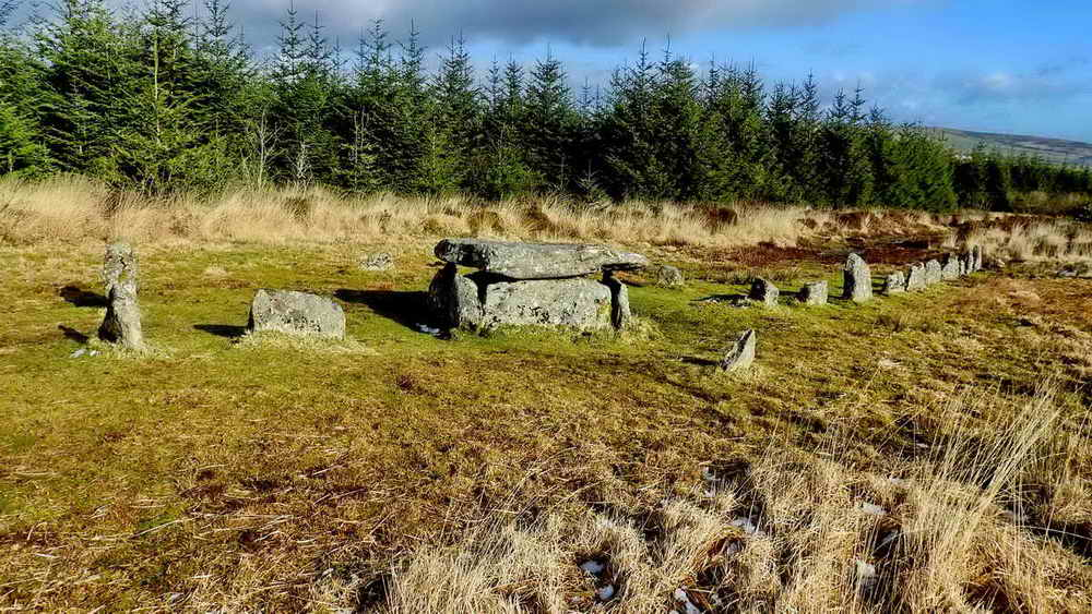 Cairn circle, cist and stone row
