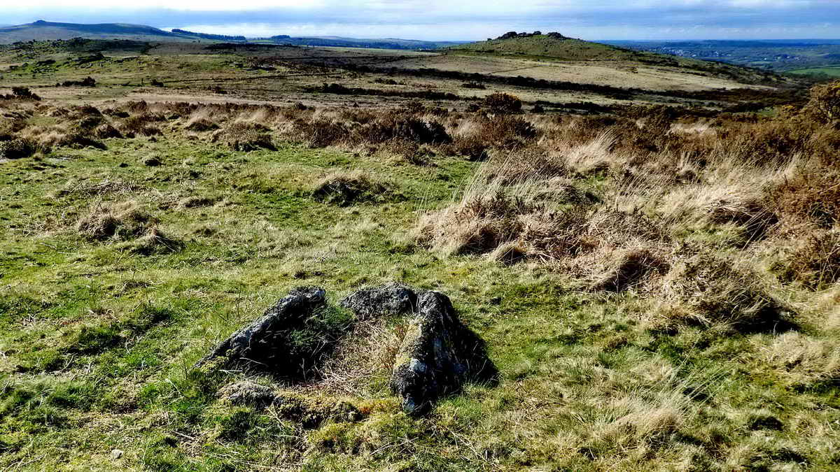 Barn Hill cist, with Pew Tor in the distance