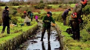 Clearing Plymouth Leat on 8 Jan. 2016. The leat was built by Sir Frances Drake in 1591,