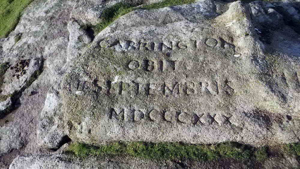 One of several inscriptions on the flat summit rocks of Dewerstone Hill