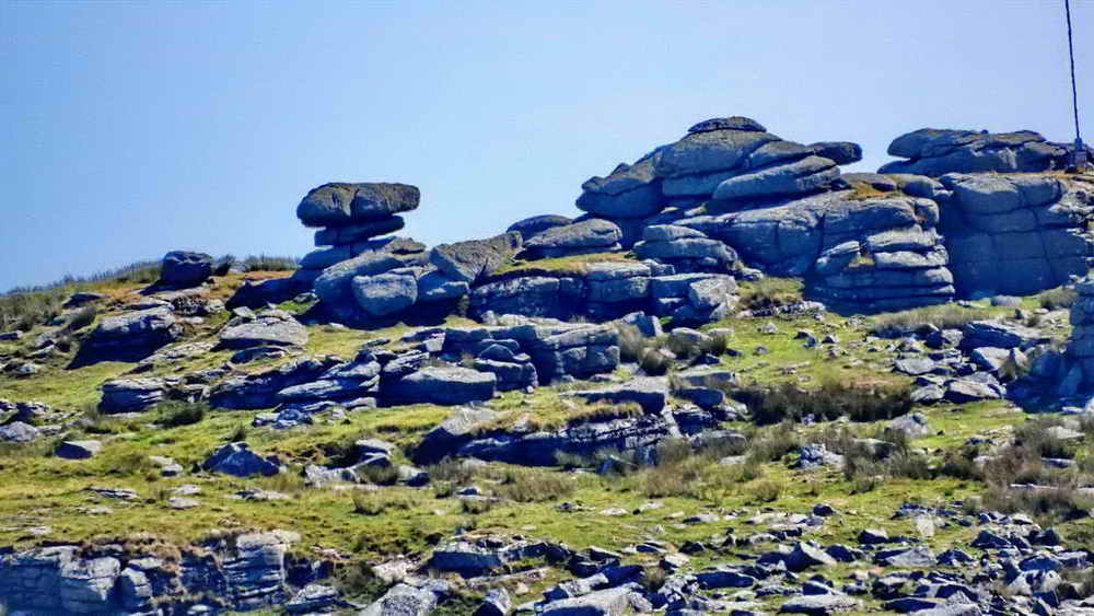 Zoomed view to the logan stone on Roos Tor