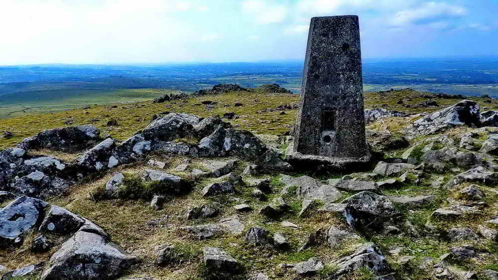 Cox Tor triangulation pillar with a view to Pork Hill car park