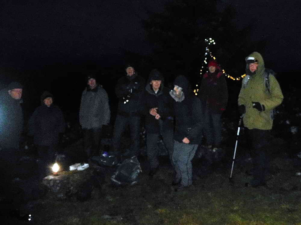 As darkness fell on Dartmoor, a few carols and libations ….. Photo: Val Barns