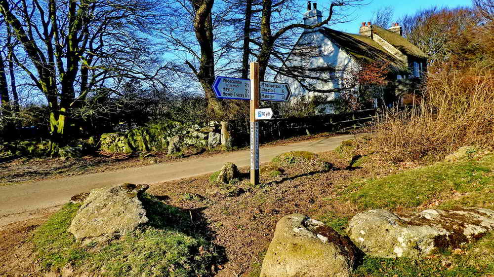 Swallerton Gate - road sign, gate and cottage
