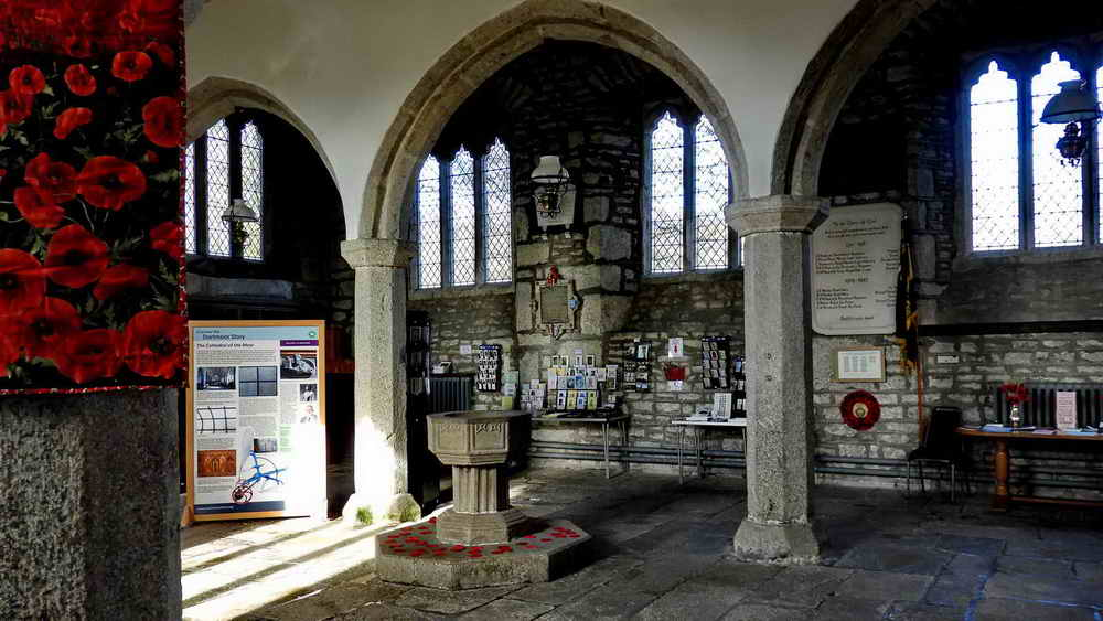 Looking inside the church, from the door to the Elford tablet - in the centre of the photograph, above the postcards